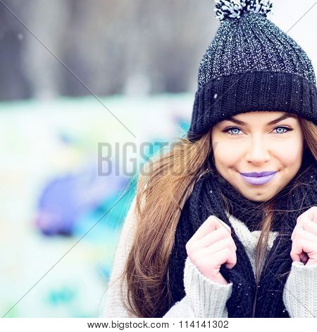Beautiful modern teenage girl winter high key portrait