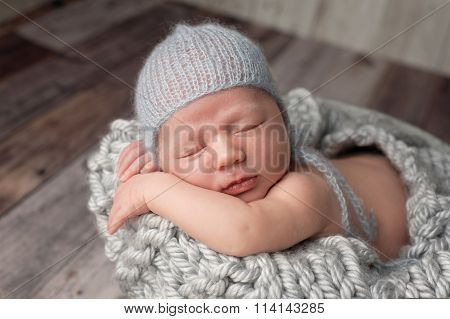 Newborn Baby Boy Wearing A Mohair Bonnet