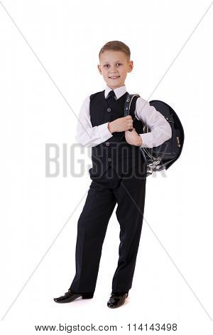 Full length portrait of a boy in a suit standing with schoolbag. Fashion kids. Education. Isolated over white background