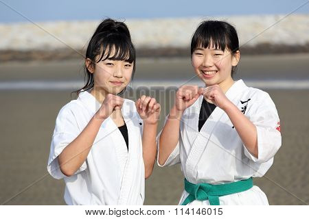 Japanese karate girls at the beach