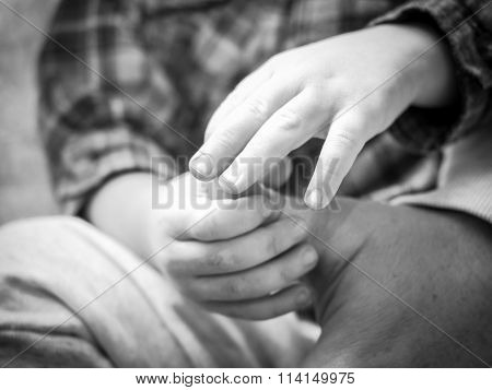 Small Child's Hands Holding Man's Hand