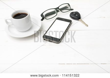 Coffee Cup With Phone, Eyeglasses And Car Key