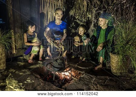 Small family gathering around the fire red