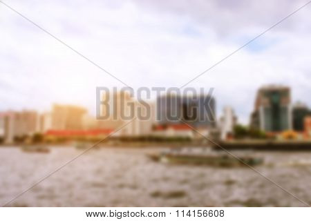 blur photo focus in city building and Jao Praya river Thailand