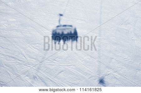 shadow of skiers on chairlift