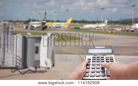 Travel Cost Calculation Concept By Calculator And Runway In Background