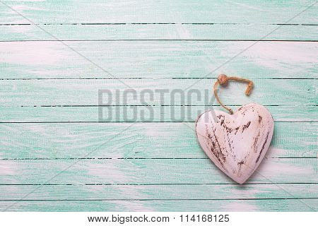 Decorative Rustic   Heart On Turquoise Painted Wooden Background.