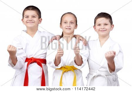 Children stand in rack of karate and showing the finger super