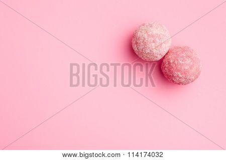 pink marzipan balls on pink background