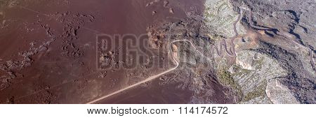 Aerial photo of Road in volcanic landscape of Plaine des Sables, Reunion Island