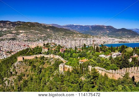 Panoramic view on castle walls, lower castle and city from the upper castle in Alanya