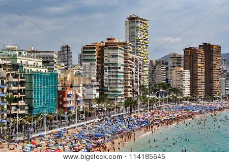 Crowded beach of Benidorm on a cloudy day, Spain