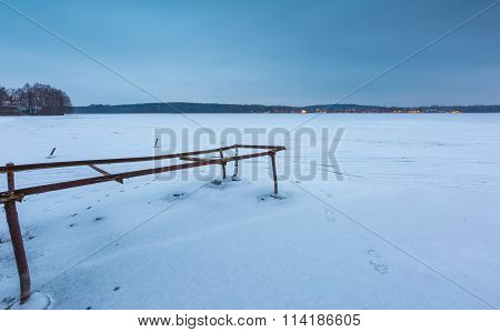 Frozen Lake With Old Destroyed Boat Hoist