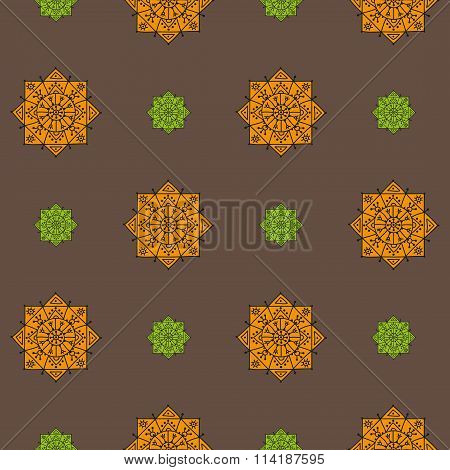 Seamless pattern with orange and green ethnic rosettes on a brown background
