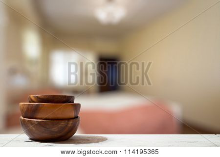 stack of empty wooden bowls on old wooden table in the bedroom