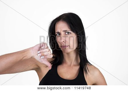 Woman showing thumbs down, negative