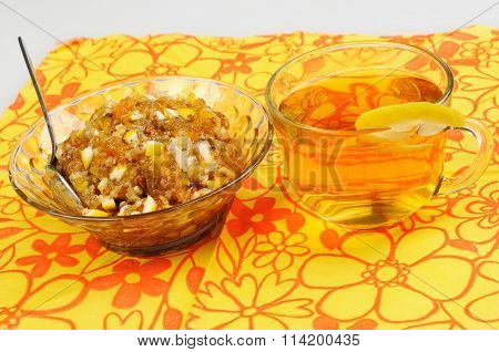 Tea With Lemon. Jam And Dried Fruits, Nuts And Dried Apricots, Honey.