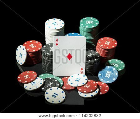 Ace surrounded casino chips on black