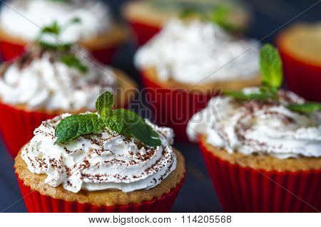 Muffins with cherry, pineapple and whipped cream