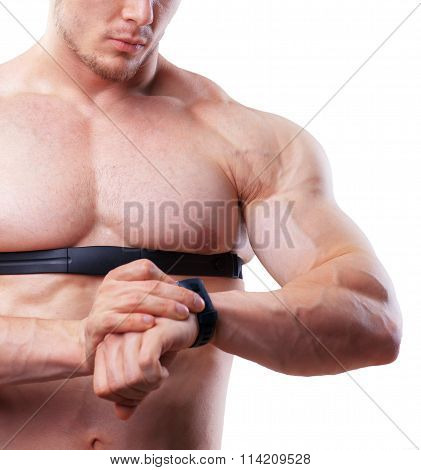 Close up shot of shirtless athlete man looking at heart rate watch.