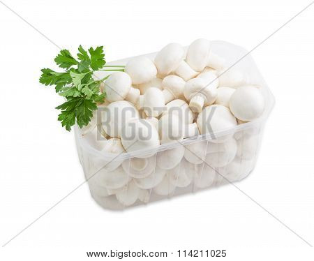 Button Mushrooms In A Plastic Tray On A Light Background