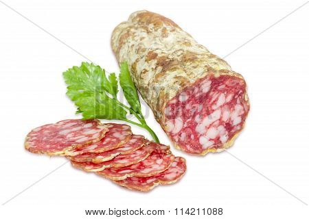 Salami And Sprig Of Parsley  On A Light Background