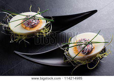 Eggs with caviar.