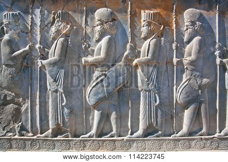 Soldiers Of Historical Empire In Ancient City Persepolis, Iran. Unesco World Heritage Site