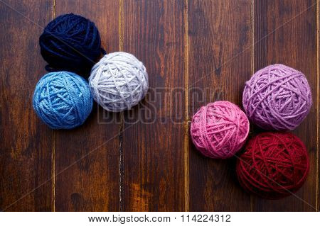Six Skeins In Red And Blue Tones Over Wooden Background
