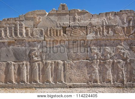 Scene With Faravahar - Relief Of Winged Sun Symbol Of Zoroastrianism In Ruined Persepolis