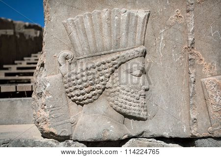 Head Of Ancient Warrior On The Destroyed Stone Bas-relief In Famous City Persepolis