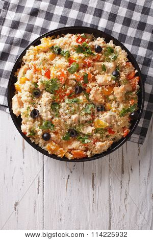 Couscous With Chicken, Olives And Vegetables. Vertical Top View