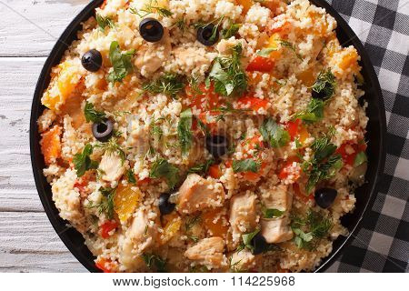 Couscous With Chicken, Olives And Vegetables Closeup. Horizontal Top View