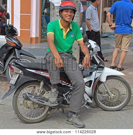 man is sitting on motorcycle outdoor in Sa Pa, Vietnam