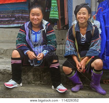 two women are sitting outdoor in Sa Pa, Vietnam