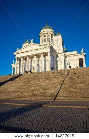 HELSINKI, FINLAND - DECEMBER 26, 2015: Tourists visit Cathedral at daytime on December 26, 2015 in Helsinki, Finland