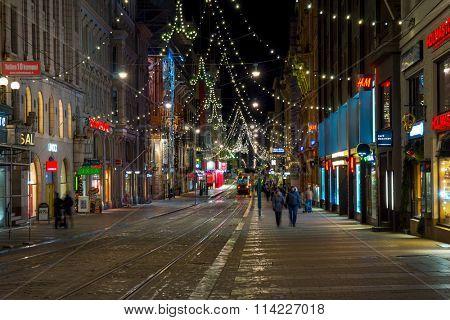 HELSINKI, FINLAND - DECEMBER 26, 2015: People walking in city center decorated for Christmas on December 26, 2015 in Helsinki, Finland