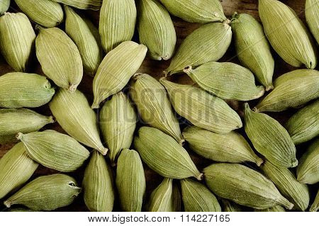 Cardamom Pods On Wooden Background