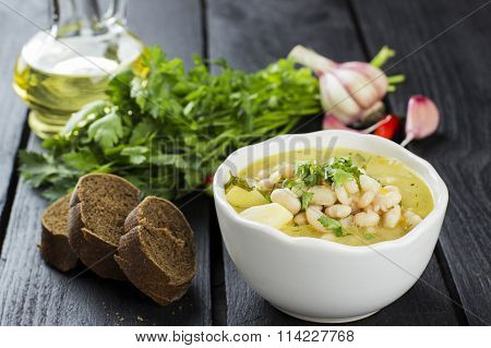Plate Of Vegetable Soup With Vegetables On A Wooden Background