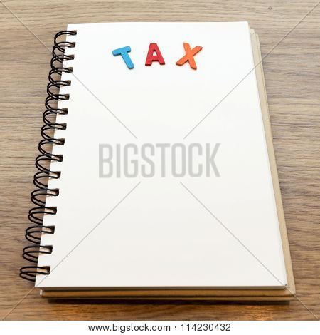 Wood Colorful Letter Word Tax Lay Down Notebook On Wood Background
