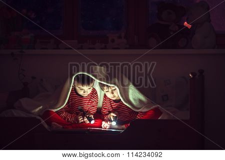 Two Sweet Boys, Reading A Book In Bed After Bedtime, Using Flashlights