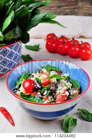Couscous salad and brown beans, with olive oil, with organic cherry tomatoes, onion, parsley and spi