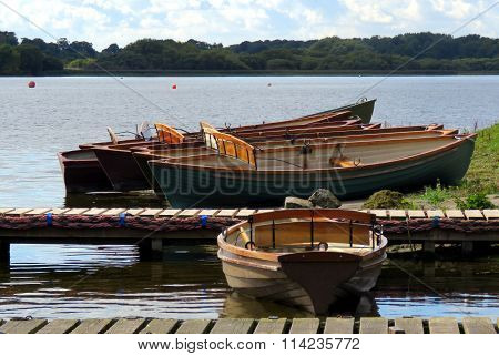 Rowing boats by the jetty