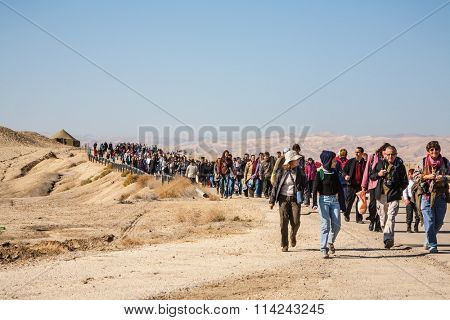 THE BORDER WITH JORDAN, ISRAEL - JANUARY 18, 2008: Day of sacred Christening of Jesus. Pilgrims and tourists back after visiting the site of the Baptism of Jesus in the Jordan River