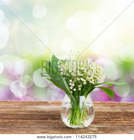 Lilly of valley on wood