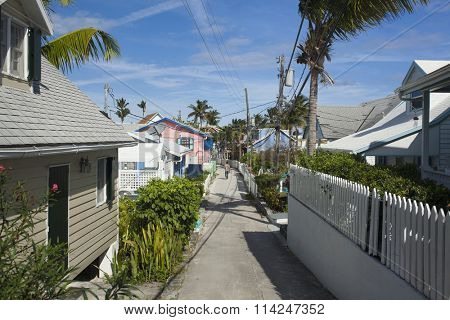 HOPETOWN, BAHAMAS- JANUARY 8, 2015: AN unidentified man walks down a narrow street in Hopetown in Elbow Cay, Bahamas