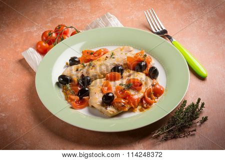 escalope with tomatoes olives and thymus