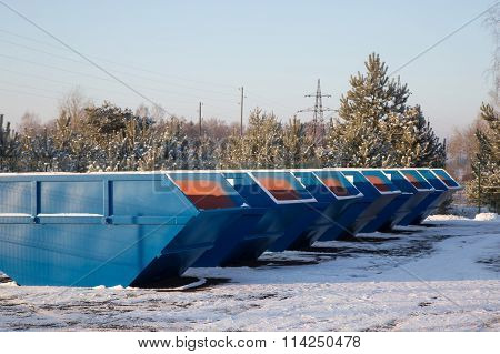 Row Of Blue Large Garbage Containers