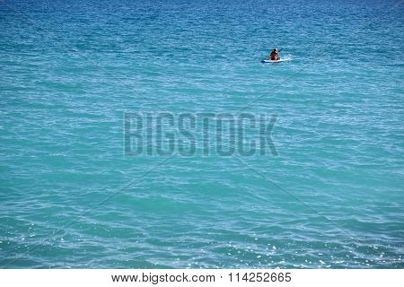 Woman Rowing Rubber Boat