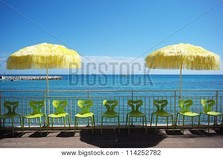 Beach Umbrellas And Plastic Chairs